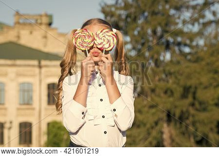 Sweet Look. Sweet Tooth Sunny Outdoors. Little Child Hold Candies. Sweet Treats. Dessert And Food. C