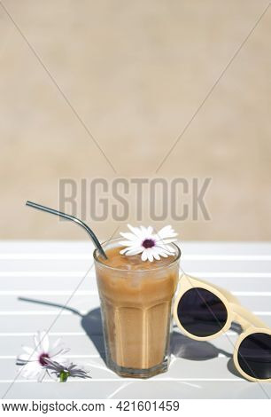 Ice Coffee Cyprus Frappe Fredo Top View On White Table, With Sunglasses. Summer Minimalistic Backgro