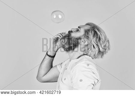 Infantility Concept. Carefree Man Soap Bubbles. Summer Vacation. Happy Playful Bearded Hipster And S