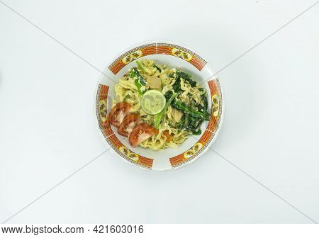 Indonesian Mie Goreng Or Fried Noodle With Egg Traditional Indonesian Or Chinese Food With Mustard G