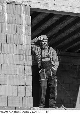Regular Day. Daily Routine At Construction. Well Done. Repairman Tired Builder Relaxing At Construct