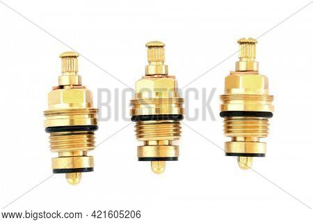 Three threaded brass collar tap glands half inch with 8 mm spline used to shut water flow off in plumbing tap systems on white background.