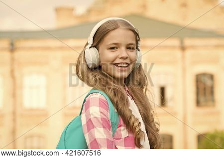 Easy Listening And Dreaming. Happy Girl Enjoy Listening To Music. Small Child Practise Listening Ski