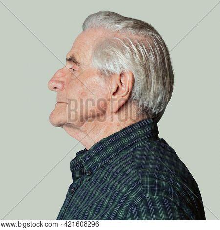 Senior man wearing a tartan shirt in a profile shot mockup