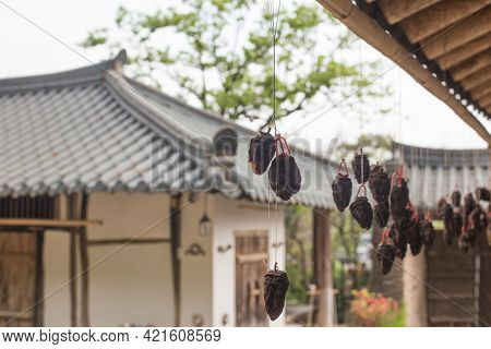 Dried Persimmons Hanging Under The Roof Of Korean Traditional Houses