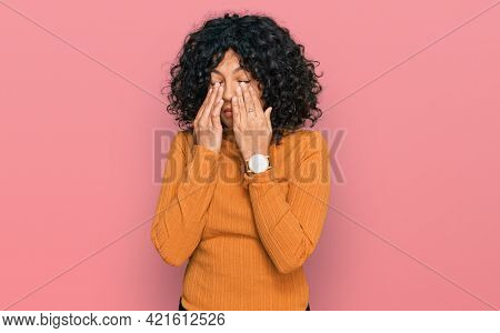 Young hispanic woman wearing casual clothes rubbing eyes for fatigue and headache, sleepy and tired expression. vision problem
