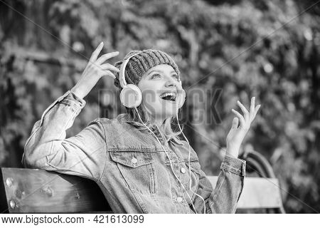 Music Is So Much Fun. Modern Technology Instead Of Reading. Relax In Park. Hipster Girl With Mp3 Pla