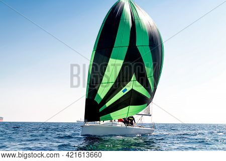 Sport Sailing Boat With A Striped Sail