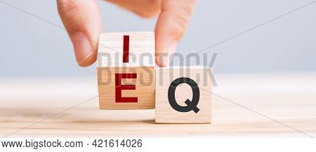 Business Man Hand Change Wooden Cube Block From Iq To Eq, Balance Between Intelligence Quotient And