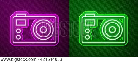 Glowing Neon Line Photo Camera Icon Isolated On Purple And Green Background. Foto Camera. Digital Ph