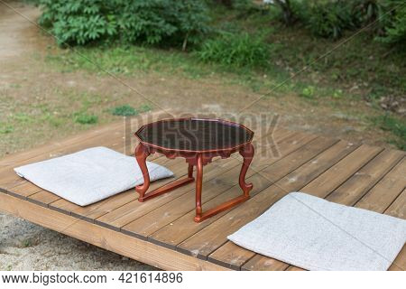 Korean Asian Style Open Building In A Calm With Tea Table