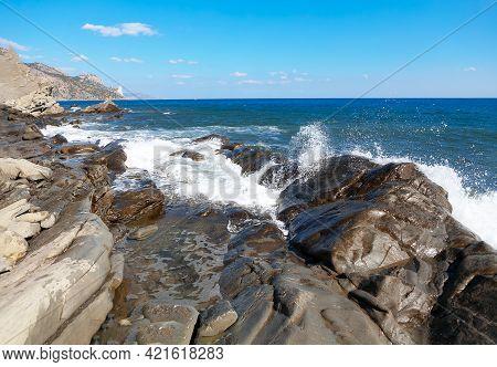Rocky Coast Of Crimea . Splashing Waves Of Black Sea . Kutlakskaya Buhta In Vesele Crimea