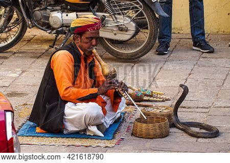 Jaipur, India - Jan 05, 2020: Man With Snake Near Amber Fort In Jaipur, India.