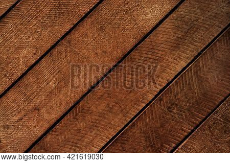 Background Texture Boards Knocked Into A Shield Diagonal Arrangement Close-up. Wooden Planks Backgro