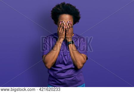 African american woman with afro hair wearing casual purple t shirt rubbing eyes for fatigue and headache, sleepy and tired expression. vision problem