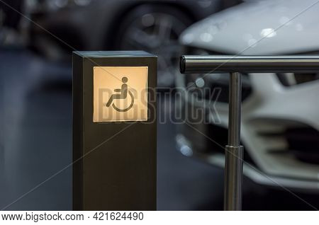 Lighting Sign Disabled Way.  Lighting Signboard Of Handicap People Way During The Light Is Glowing.