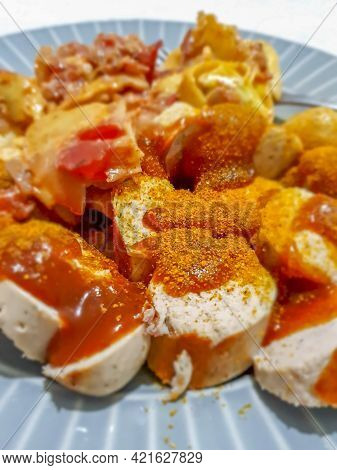 German Currywurst - Pieces Of Curried German Bratwurst, Sausage With Ketchup And Currypowder