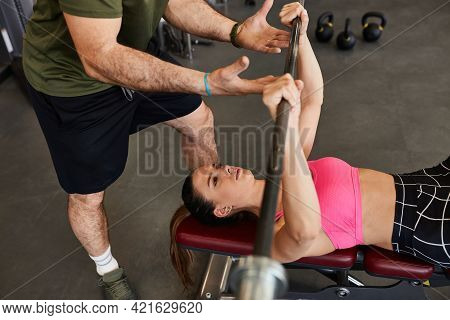 Young Fit Determined Sports Woman Doing Bench Press Exercise. Female Person Weightlifting. Image Sho
