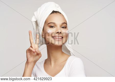 Woman With A Towel On Her Head Shows A Positive Gesture And Clean Skin Cosmetology Dermatology Model
