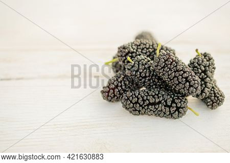 Fresh Black Mulberry On The White Wooden Table. Mulberry Close-up. Organik Freshly Harvested Berries