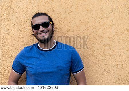 Young Latino Man With Sunglasses Smiling Looking At Camera. Horizontal Shot