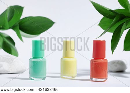 Collection Of Colored Nail Polishes, For Manicure Or Pedicure, On A White Background With Hard Shado