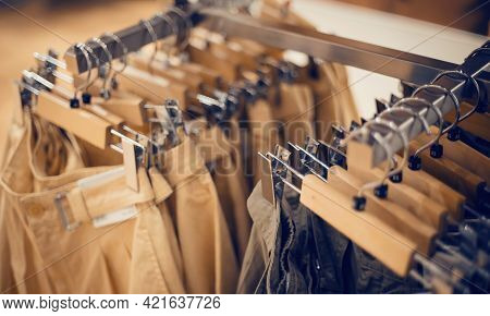 Hangers With Clothes On The Rail In The Store. Shopping In Store. Clothes On Hangers In Shop For Sal