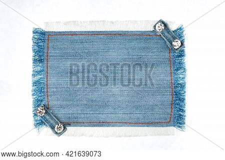 Frame Denim With Two Straps Jeans And Rhinestones, Lies On The Light Denim, With Space For Your Text