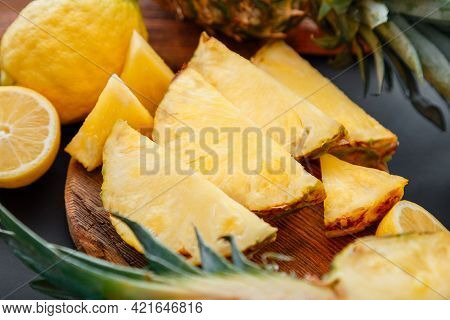 Pineapple On Cutting Board. Summer Tropical Fruit Sliced Pineapple Slicing Cooking Process In Kitche