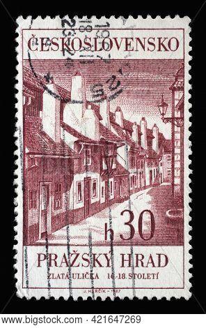 ZAGREB, CROATIA - SEPTEMBER 18, 2014: Stamp printed in Czechoslovakia shows Golden street at Prague Castle, circa 1967