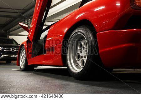Kiev, Ukraine - May 22, 2021: Red Luxury Supercar Lamborghini Diablo Koenig With Open Door. Exclusiv