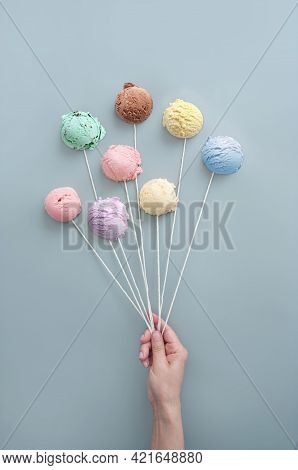 Hand Holding Ice Cream Cones Like Balloons, Summer Ice Cream Concept