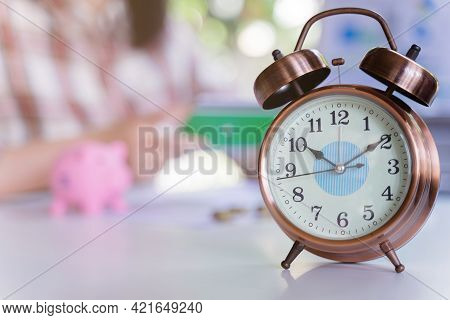 Retro Alarm Clock Vintage And Background Person Working About Saving, Finance, Calculate Passbook. C
