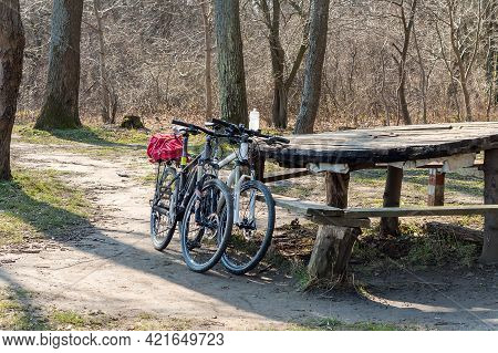 Kaliningrad Region, Russia. 18 April, 2021. Two Bicycles Near A Bench. A Bicycle Trip Through The Fo