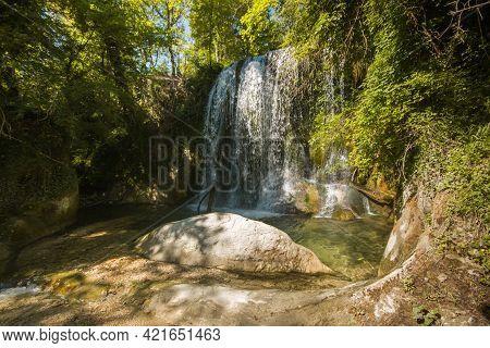 View Of Wild Waterfall (cascata De Lu Vagnatò) Near Sarnano, National Park Of Monti Sibillini, March