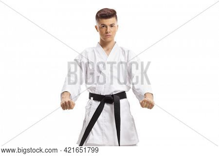 Teenager in kimono making a martial art pose isolated on white background