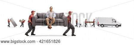 Movers carrying a couch with a seated mature man and other movers loading a van isolated on white background