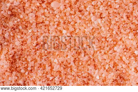 Pink Sea Salt Close-up. The Texture Of Salt Crystals. The Background Is Made Of Natural Ingredients.