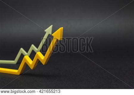An Uptrend, Increased Sales, Or Increased Value. Graphic Arrows Pointing Upwards On Black Background