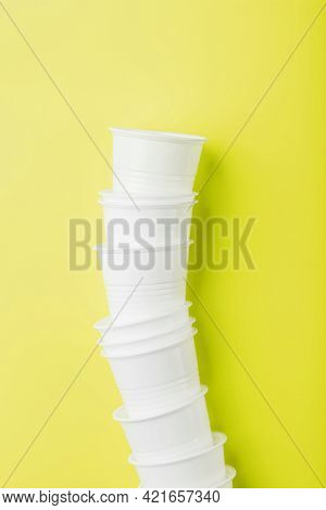 Disposable Plastic Tableware On A Yellow Background With Free Space.