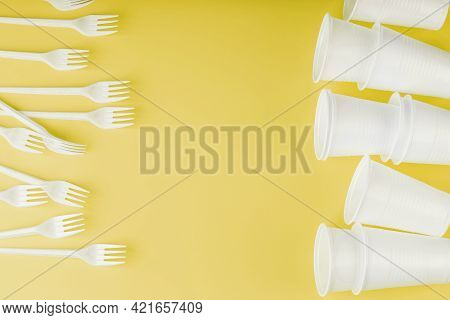 Plastic Tableware On A Yellow Background With Free Space.