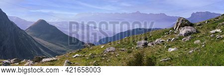 Panorama Of The Alpine Mountains. Ridges And Peaks Are Visible In The Background. Large And Small St