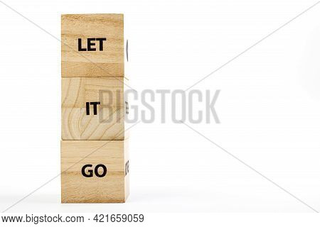 Wooden Cubes With The Inscription Let It Go On A White Background Close Up