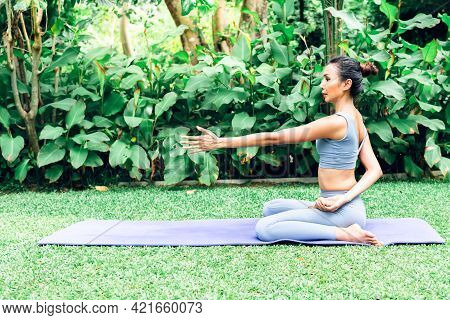 Asian Attractive Young Woman Have A Beautiful Body, Playing Yoga In An Elegant Posture, In The Green