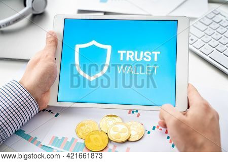 Russia Moscow 06.05.2021 Businessman, Tablet. Logo Of Software Cryptocurrency Wallet,gateway Trust W