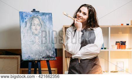 Art Studio. Female Artist. Enjoying Painting. Creative Hobby. Smiling Woman In Apron Canvas Portrait