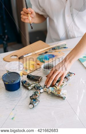 Artist Workplace. Painting Art. Skill Talent. Professional Painter Woman Hands With Paintbrush Choos