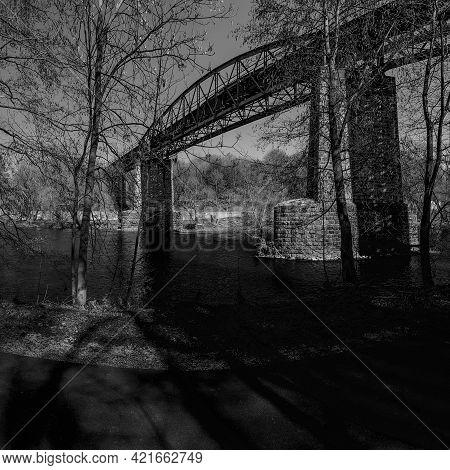 Kadan, Czech Republic - March 30, 2021: Historical Iron Train Brindge Above Ohre River Sunny Spring