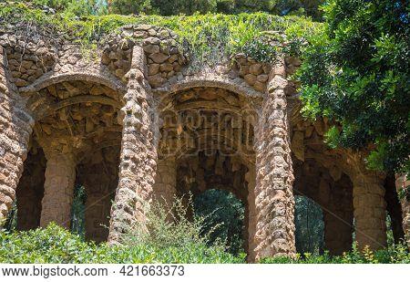 Stone Colonnade Resembling Tree Trunks. Park Guell, Barcelona, Spain.