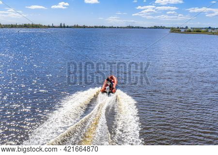 Rigid Inflatable Boat Sailing Fast Over Water Of Dutch Lake In Friesland, The Netherlands.